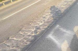 buche asfalto SS 236